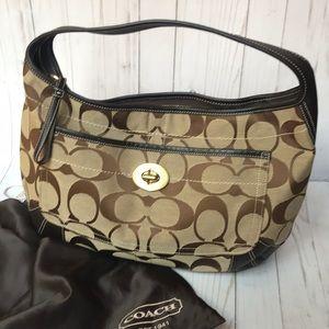 Coach signature bag.